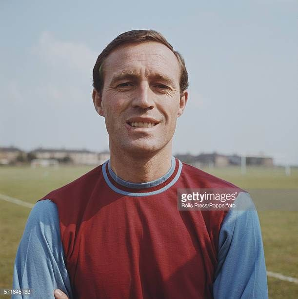 English footballer and forward with West Ham United Jimmy Bloomfield posed wearing West Ham team kit in August 1966