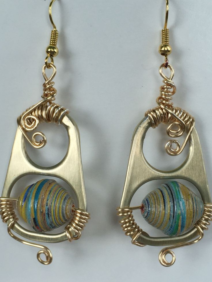 Guess from what is it made out of? Can top from Cat's Food.  #jewelry #earrings #arts #crafts #can #cat #food #paper #beads #recycle #upcycle  http://www.marimartscrafts.com/