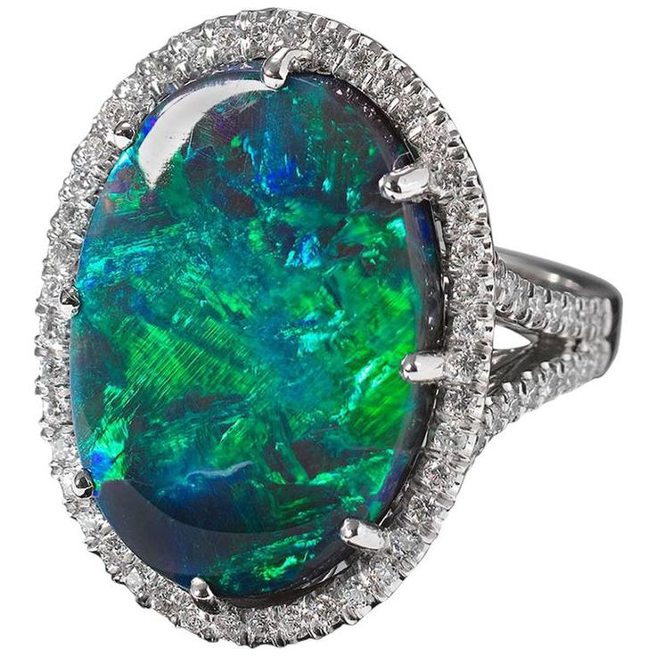 Lightning Ridge Black Opal and Diamond Ring | From a unique collection of vintage cocktail rings at https://www.1stdibs.com/jewelry/rings/cocktail-rings/