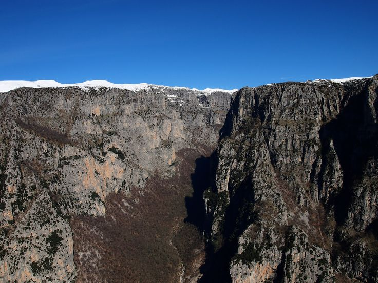 https://flic.kr/p/p1NnEc   Vikos Canyon   The Vikos Gorge is a gorge in the Pindus Mountains of northern Greece. It lies on the southern slopes of Mount Tymfi, with a length of about 20 km, depth ranging from 120 to 490 m and a width ranging from 400 m only a few metres at its narrowest part.