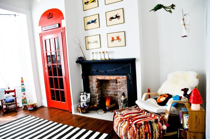 Love so many things about this room....striped rug, grouping of car prints, telephone booth door