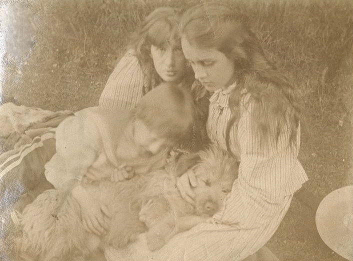 Siblings Virginia Woolf, Vanessa Bell, and Adrian Stephen with the family dog.