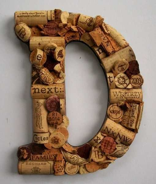 pinterest wine bottle decorating ideas | Wall decoration made with wine bottle corks, D letter recycling bottle ...