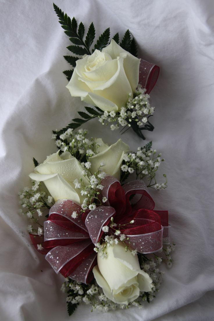 burgandy corsage and boutonniere