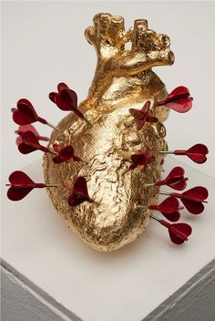 Yes, in the deep you have not lost your heart and your heart is not only of gold, it is of the best what is yours, your own. And so many loves have hurt you. But no mine. Between all the little arrows you wouldn't find the mine. My love is the blackish red blood in your heart.