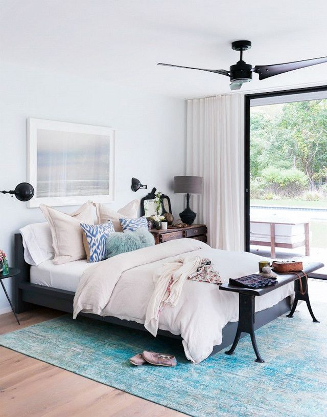 Direct attention away from an unmade bed by creating a focal point. Follow designer Athena Calderone's lead by selecting three types of accent cushions of varying colors and textures. Layer...