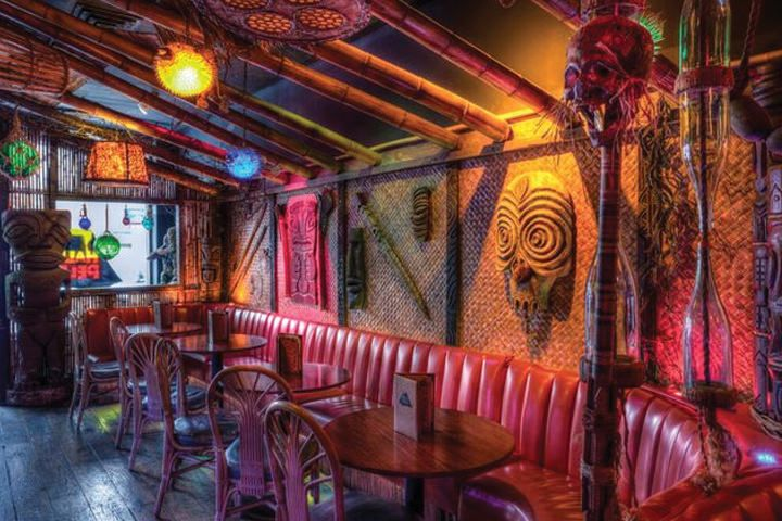 Hale Pele in Portland, OR • The man behind the B.G. Reynolds mixers line, Blair Reynolds' tiki obsession is best expressed in his bar, Hale Pele. It's lush with palm fronds, bamboo and tiki paraphernalia.