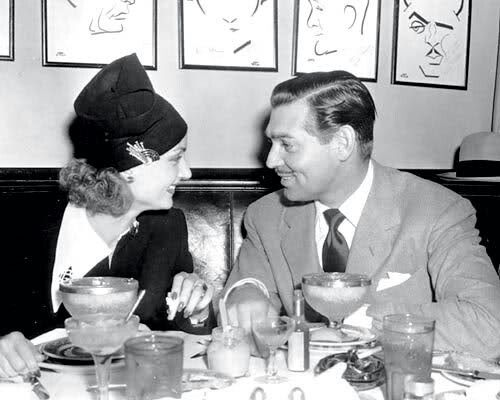 Carole Lombard & Clark Gable at The Brown Derby restaurant.