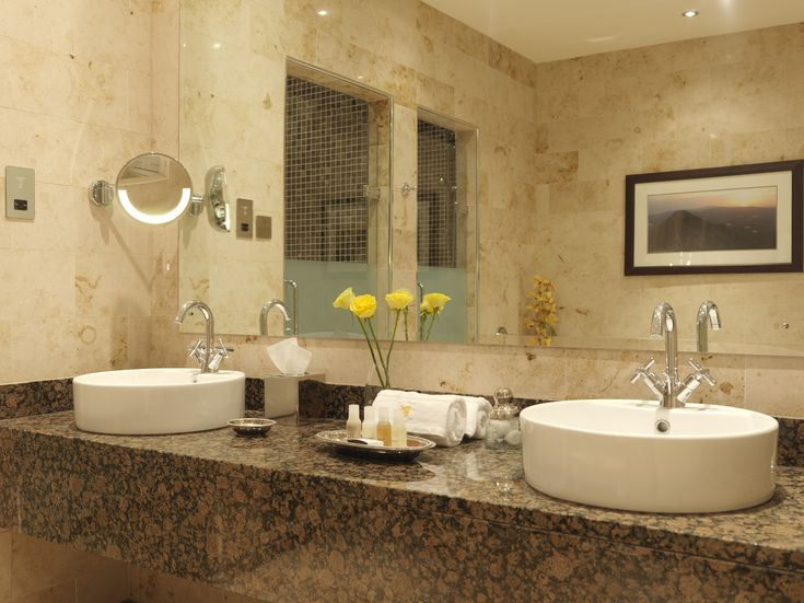 classy double white round bowl sink on brown granite countertop mirror vanities in luxurious venetian hotel - Mirror Tile Castle Ideas