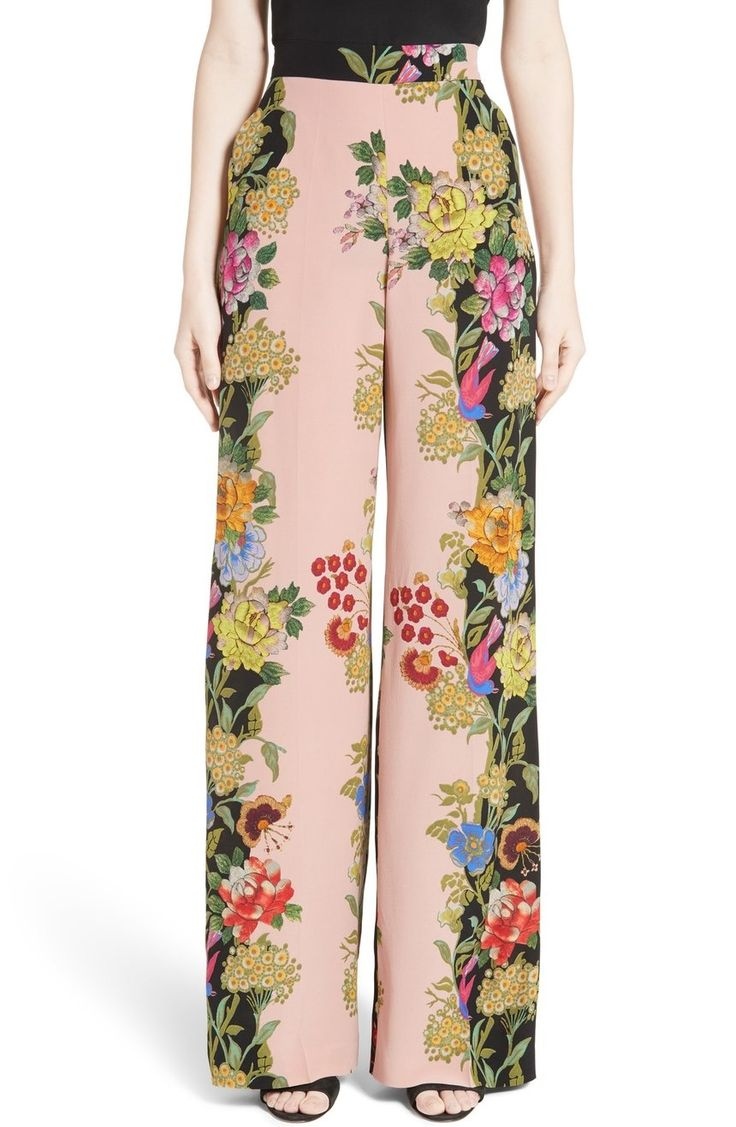 Inspired by the blossoming motifs of early 20th-century Mexican paintings, flowering vines trail up the flowy wide-leg silhouette of these silk pants.