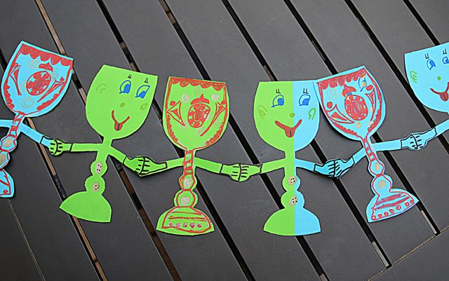 A simple and cute Passover craft to decorate your home—a dancing wine goblet paper chain!