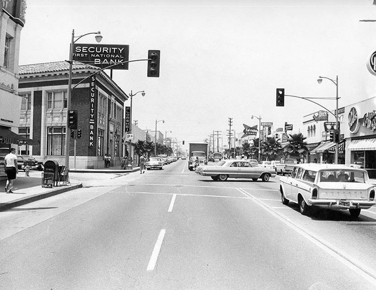 This is a view looking north on Lankershim Boulevard at Weddington Street in North Hollywood (1965). A 1963 Chevrolet Impala Coupe is making a left turn onto Lankershim while a Rambler station wagon is stopped at the light. Bob's Coffee Shop on the right and the Security-First National Bank on the left (now The Federal Bar). When my first girlfriend's father died, she went to work at that Bob's Big Boy to support herself. #chevroletimpala1970