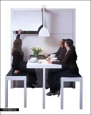 Table and seats can be pulled out > clever compact dining room in a box