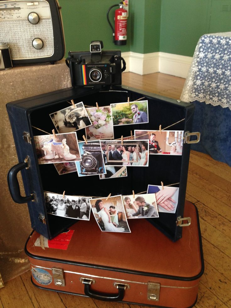 Clever way to display photographs, spotted on Always You Photography stall at the Bath Vintage Wedding Fair in September 2015. Use an open vintage suitcase as a display rack by running string from one side to the other. You could also peg cards, photos and smaller textile items in this way.