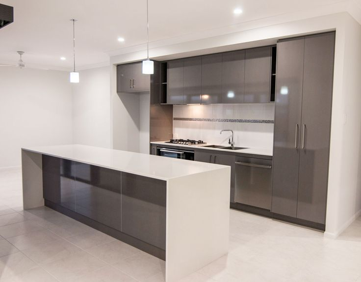 new client home kitchen in platinum colour board. Dark grey on white with waterfall stone benchtop to island bench.