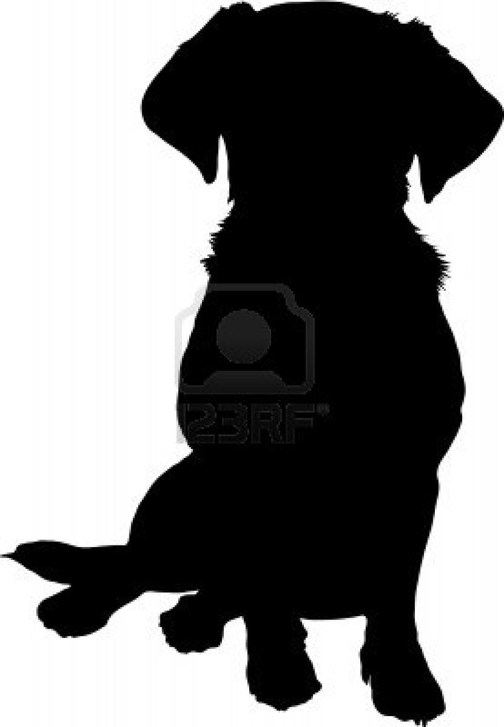 A black silhouette image of a puppy sitting facing the viewer  Stock Photo