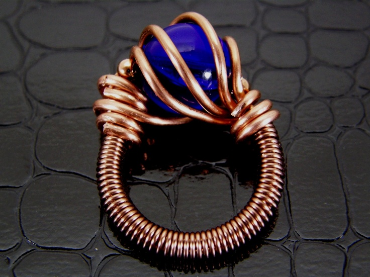 Copper Wire Ring with Dark Blue Glass Bead Hand Crafted & Wire Wrapped. $17.50, via Etsy.