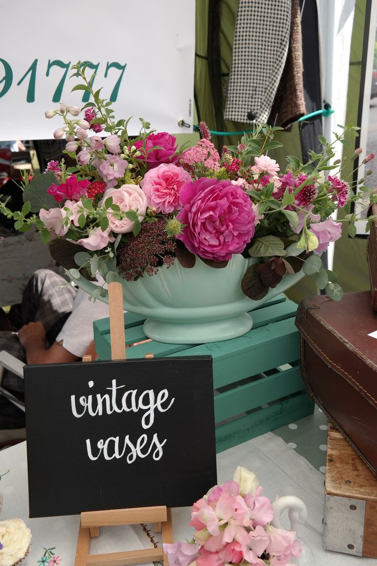 Pink garden flowers in a vintage vase- perfect for a wedding.