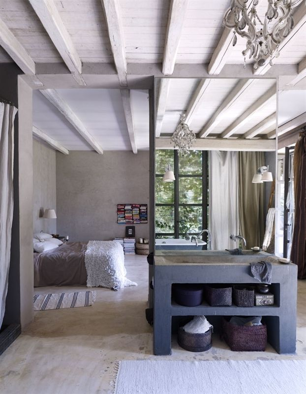 Clever small space design. Love the open concept. Parsons style vanity with large frameless mirror. Ceiling Beams. Wall privacy divider. #modern