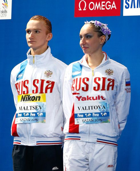 Aleksandr Maltsev Photos Photos - Silver medallists Aleksandr Maltsev and Darina Valitova of Russia pose during the medal ceremony for the Mixed Duet Technical Synchronised Swimming Final on day two of the 16th FINA World Championships at the Kazan Arena on July 26, 2015 in Kazan, Russia. - Synchronised Swimming - 16th FINA World Championships: Day Two
