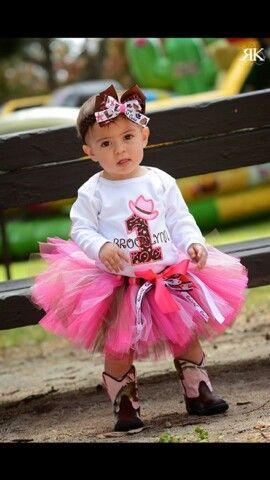 Brooklyn's 1st Birthday Cowgirl style cowgirl tutu and brown and pink books to adorable. Cow -Baby girl celebrates.