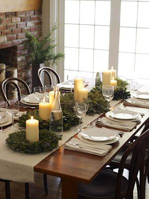 Christmas table setting using wreaths from Dollar Tree and candles