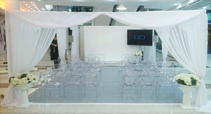 White drapes. Bespoke. shopping centre. wedding. Events.