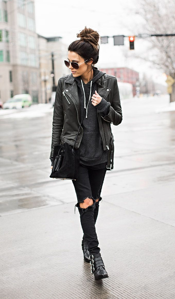 Christine Andrew shows off the rocker girl style perfectly in these distressed black jeans and punky leather buckle boots. We love it! Jacket: Moto Topshop, Sweater: Ily Couture, Denim: Nordstrom.