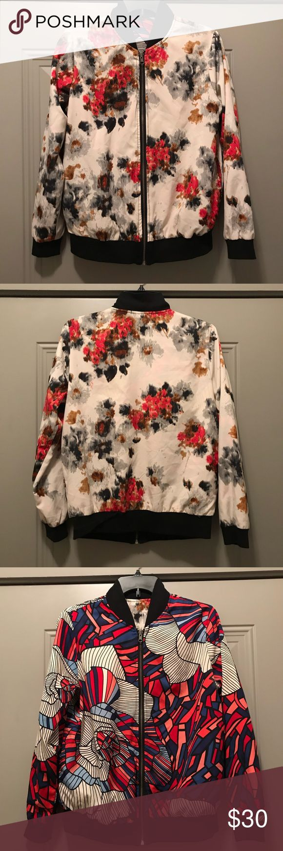 Reversible lightweight bomber jacket Floral print on side! Geometric print on the other! Flip zipper! Pockets on both sides! Get two looks for one price ! No tag due to reversible nature. Will fit a medium or large! Jackets & Coats