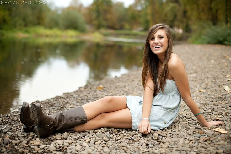 A brunette teen female high school senior poses for her senior portraits session while wearing a summer dress and dangling her feet in the water. Description from pinterest.com. I searched for this on bing.com/images