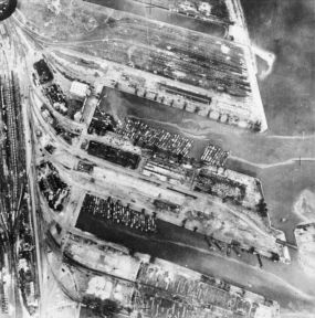 A reconnaissance photograph of Dunkirk harbour after attacks by RAF bombers, 19 September 1940. Substantial damage has been caused to dock installations and some of the invasion craft. After the war, Arthur Harris wrote that it had become customary to allow aircrews in the final stages of training to undertake the routine bombing of coastline targets, which could be identified and hit with little difficulty. C 1819.
