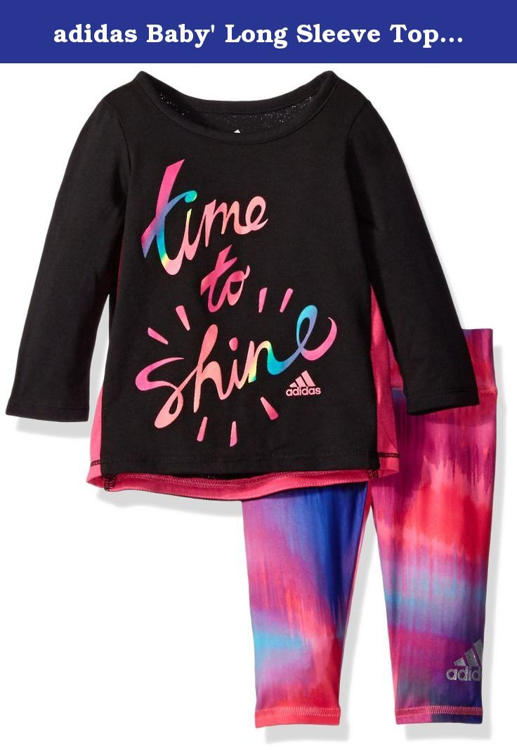 adidas Baby' Long Sleeve Top and Legging Set, Caviar Black, 3 Months. Graphic tee features contrast side seam insets and faced drop-tail back hem. Screen print embellishments have specialty inks and incorporate the Adidas brand mark. Printed tight with all over seasonal prints and screen-printed silver foil Adidas brand mark on lower left leg.