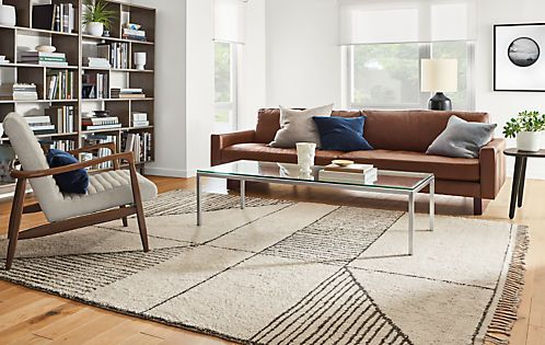This wool-blend rug is hand knotted with a pattern inspired by vintage Middle Eastern designs. The large-scale graphic provides a modern foundation for your room. One end of the rug features long, braided fringe and the other has a turned hem with pick-stitch detail for an extra bit of style. Please note that shedding is a natural occurrence in high-quality wool rugs, but will decrease over time. The amount of shedding will depend on the traffic pattern and use of your rug.