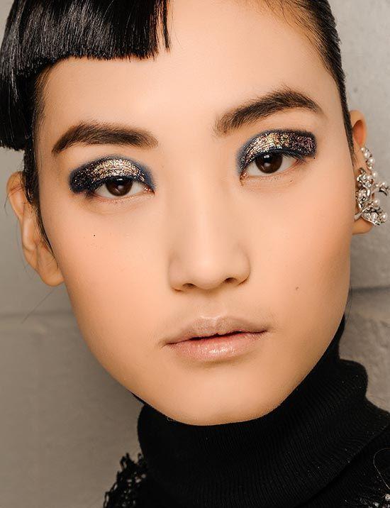 Thakoon A/W 2013 runway makeup look. Navy & gold glitter