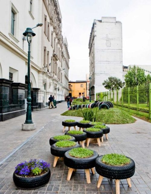 Peru: Invasion Verde, installed 2010.    This public park in Lima was created in the middle of the the city, and incorporates recycled tires for planters and a children's playground. A few rolling hills and grass-cushioned benches complete Lima's urban public garden.