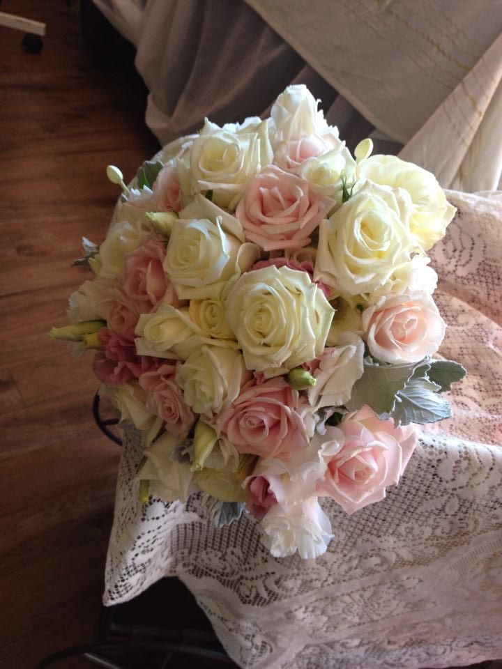 white pink roses dusty miller white lisianthus