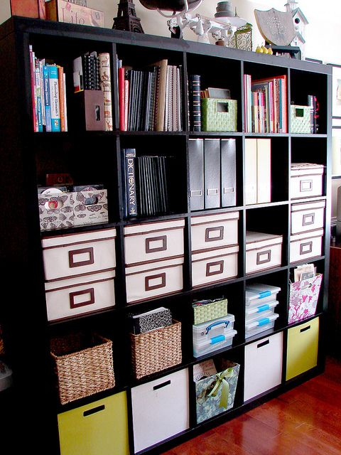 Ikea Expedit Bookcase I want this to hold back packs, mail, mittens & anything else that clutters around my garage door right now!