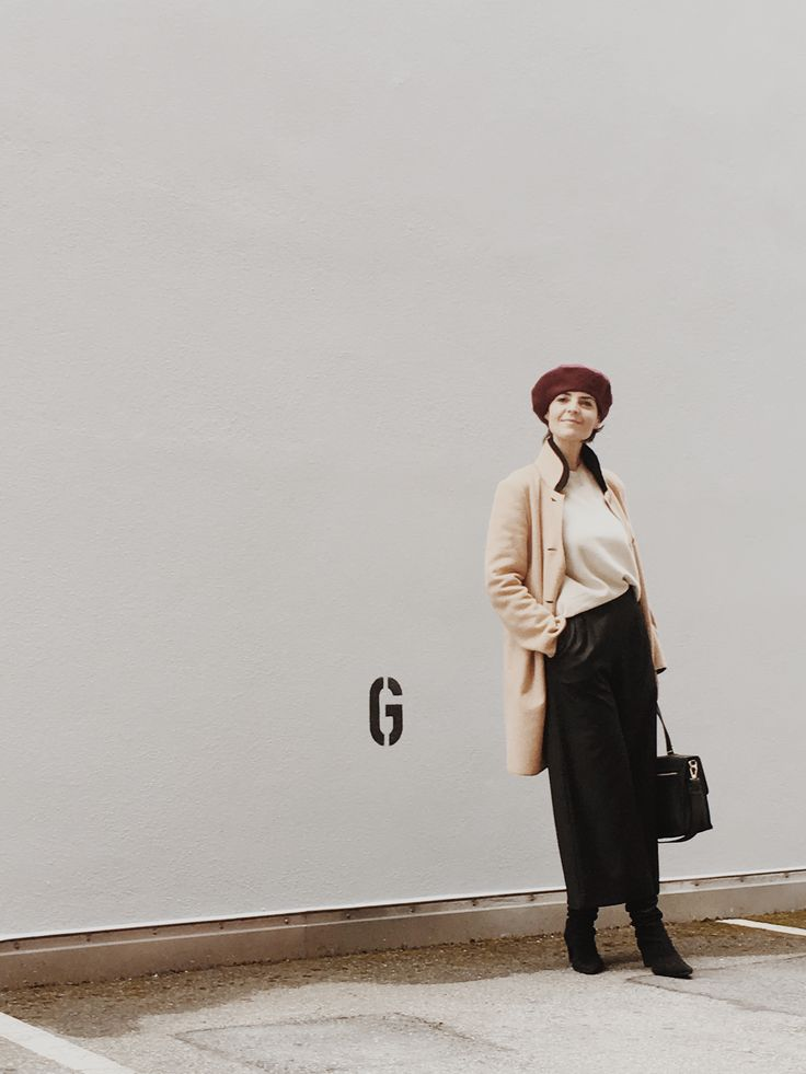 Patricia Panos style, wearing black long skirt by OTHER STORIES, ecru knit jumper, burgundy beret, winter coat by MAJE and black cross body bag by FURLA
