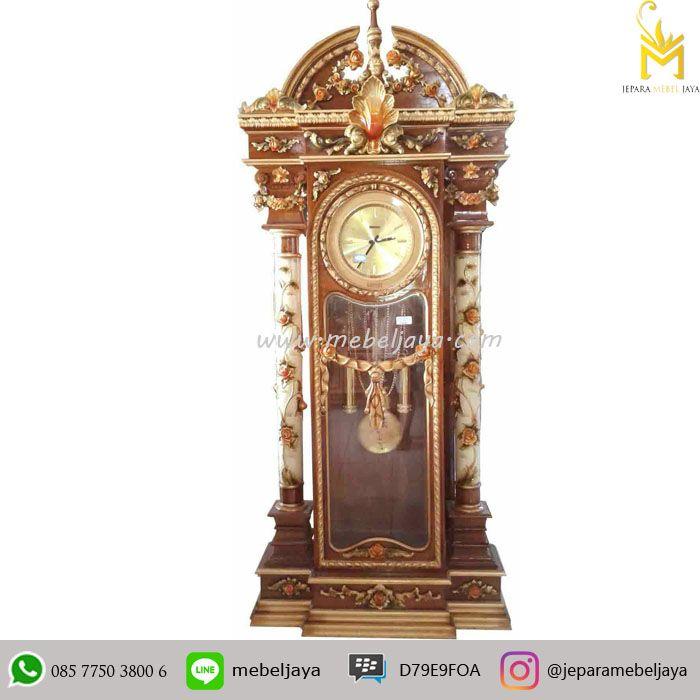 Jual Almari Jam Hias Jati Mewah Jepara Terbaru - almari jam bandul dengan ukiran bunga warna dan di desain secara mewah dengan kualitas terbaik.