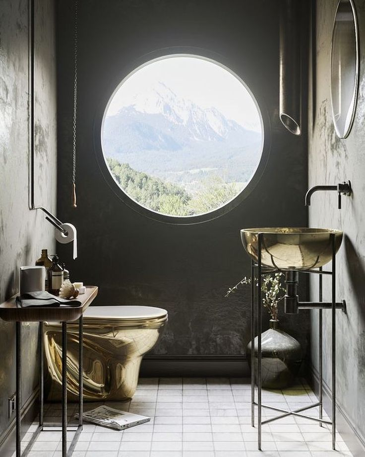 Toilet. Whit. A. View. Most luxurious bathroom find since a long time. This stelar golden toilet and sink in combination with a black wall that offers a direct view through the well-spaced porthole on the most scenic landscape is simply...