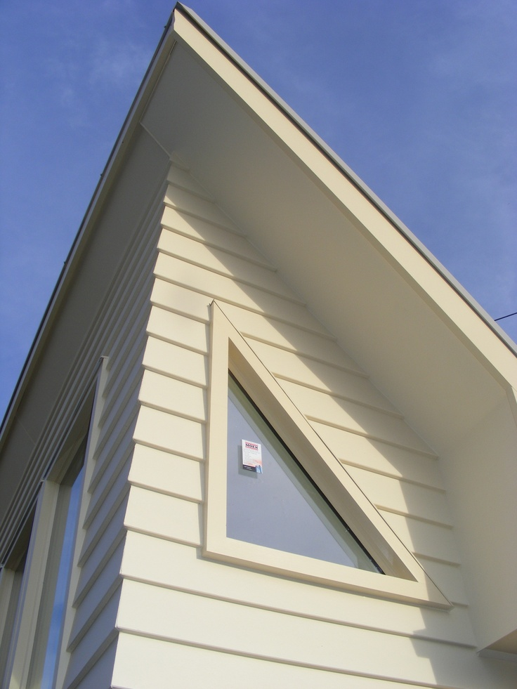 I love the cute triangle window. When all the blinds are drawn light still gets in and you can see the weather.it also often lines up with the full moon!  The crisp lines of the cladding meeting at the corners is lovely