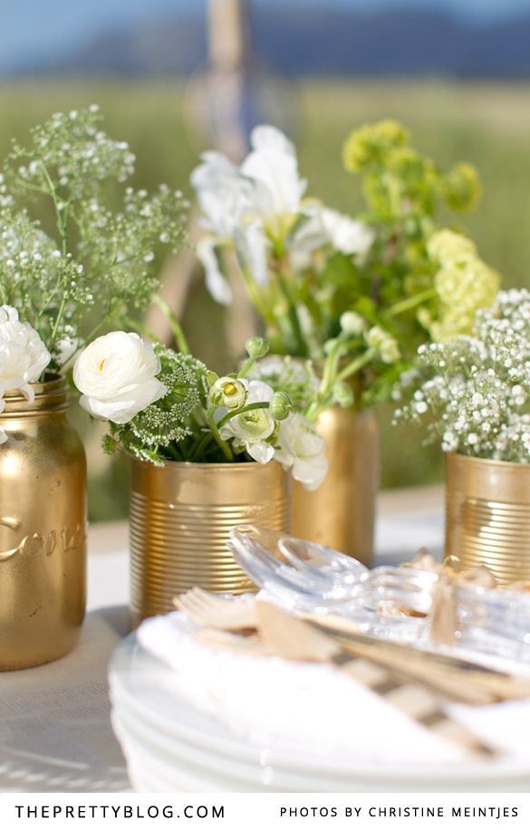 """It was with much excitement that we revealed our Boere Chic, Farm Girl Gone Glam bridal shower yesterday. Together with Annari from Nelle Cakes, we dreamed up a gorgeously """"now"""" look, which is oh so easy to recreate using bits and bobs that you can take from your home or get hold of for really cheap. We transformed old food tins and Consol bottles into glamorous vases and even our wellies got a revamp, using nothing but a tin of spray paint!"""
