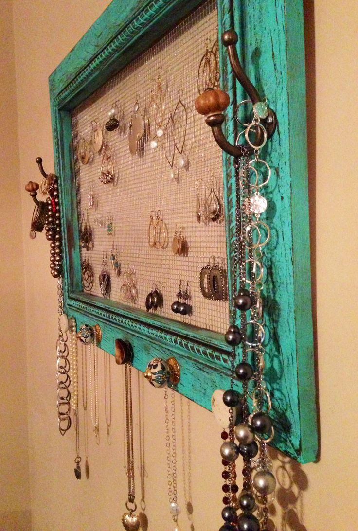 Jewelry organizer painted and distressed pic frame. Could use a window frame also if the glass is removed. Add chicken wire or radiator cover (painted.)