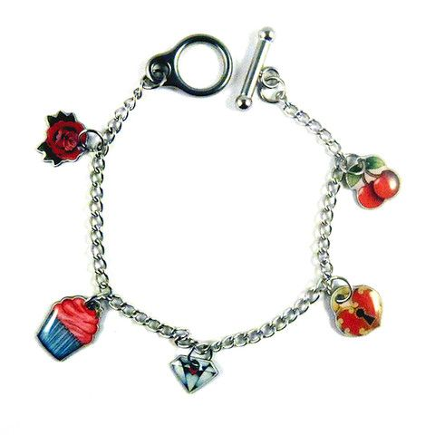 Rockabilly Doll Charm Bracelet:Jubly Umph paints pictures in watercolors and indian ink creating characters with mysterious eyes and curious occupations! These bracelet charms have been created from an original painting and are made from resin and stainless steel. They feature 5 cute Jubly-Umph charms, are light weight and waterproof and measure 7 inches. This one has a rose, diamond, cupcake, cherries and a... $35.00