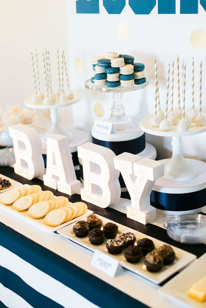 Lovely dessert table at a navy and gold baby shower see more party planning ideas