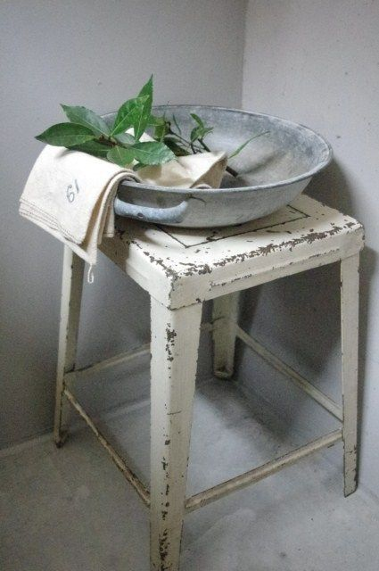 zinc bowl and vintage metal stool would look great in a vintage styled bathroom