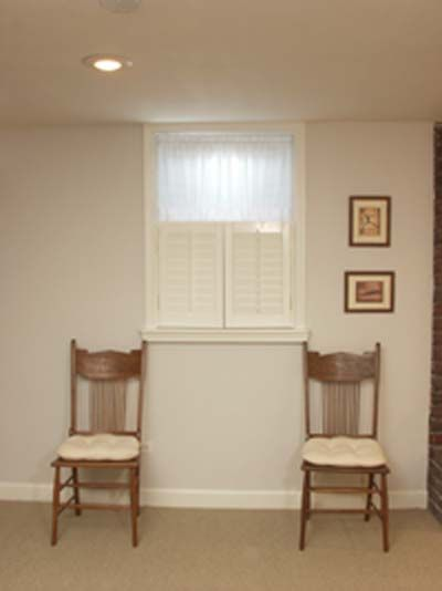 """fake"" a bigger window in a basement, use shutters below small window and frame it out like the window is larger"