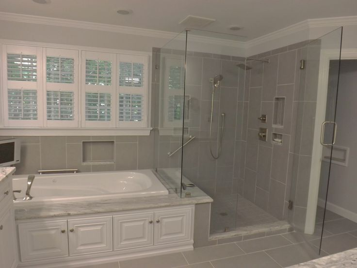 gorgeous remodel bathroom ideas with white bathtub gray shower wall glass shower door and white window