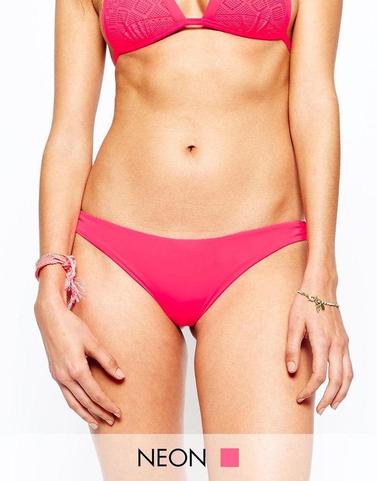 Bikinihose von Undiz aus Stretchmaterial für Bademode tief sitzender Hüftslip Rückseite mit brasilianischer Passform Handwäsche 90% Polyamid, 10% Elastan exklusiv bei ASOS