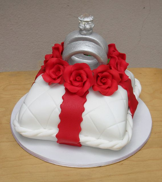 Happily Ever After by sweetobsessions, via Flickr a pillow wedding rings wedding cake White/red and silver